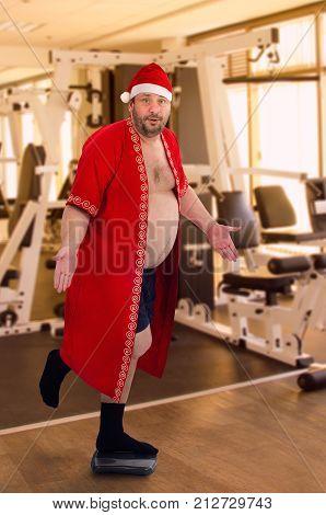 Fat Santa Posing On Left Leg In The Gym