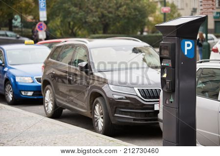Parking machine with solar panel in the city street. Pay On Foot Parking System