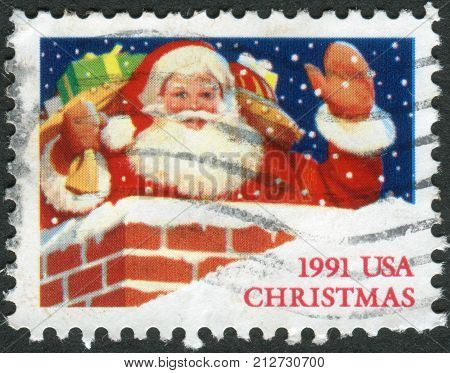 USA - CIRCA 1991: Postage stamps printed in USA Christmas Issue shows Santa Claus in Chimney circa 1991