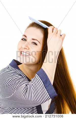 Woman Brushing Her Long Hair Using Comb