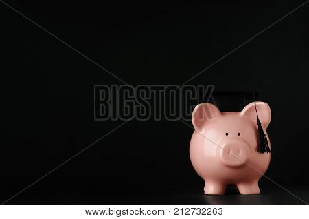 Pink Piggy Bank Wearing Mortarboard On Black Chalkboard Background