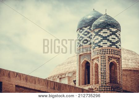 Color image with some madrasa towers in Khiva Uzbekistan.