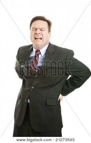 Businessman with a backache, in terrible pain.  Isolated on white.