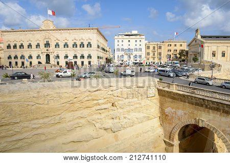 Valletta Malta - 31 October 2017: people walking in front of Auberge de Castille. The Prime Minister office. Valletta Malta.