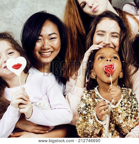 Lifestyle and people concept: young pretty diversity nations woman with different age children celebrating on birth day party together happy smiling, making selfie. African-american, asian and caucasian close up