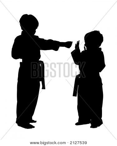 Silhouette With Clipping Path Of Children Doing Martial Arts