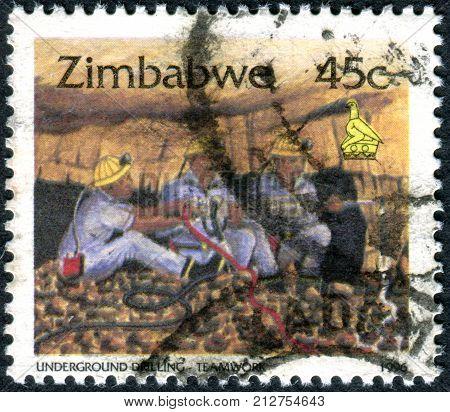 ZIMBABWE - CIRCA 1996: A stamp printed in Zimbabwe shows the Underground Drilling - Teamwork circa 1996