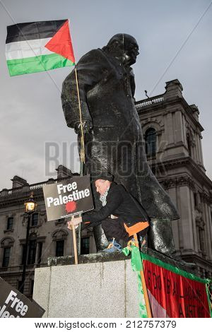 4th November 2017 London United Kingdom:-Pro palestine protester stanind on the statue of Winston Churchil in parliment square