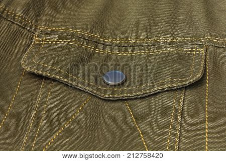 On the clothing is sewn a pocket valve with a button clasp