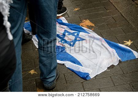 4th November 2017 London United Kingdom:-The Israeli flag on the ground at a pro palestine rally