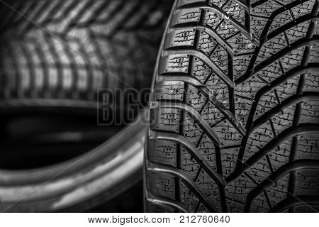 Winter tire close-up. Texture of car tire tread.