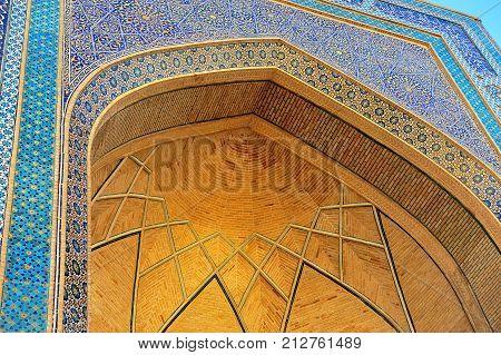 Bukhara: facade of madrasa golden arch ornament