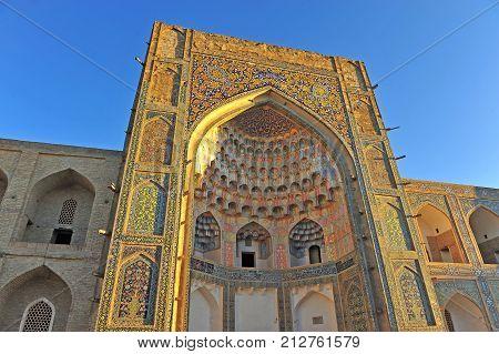 Bukhara: the medieval Madrasa gate on sunset