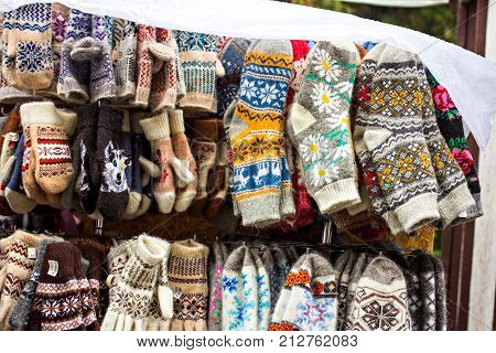 Knitted Gloves And Socks With Colorful Ornaments For Sale On The Market