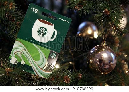 Camberley, Uk - 31 Dec 2016: British Starbucks £10 Gift Card Or Voucher, Nestled Among The Branches