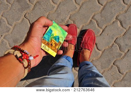 Khiva uzbekistan. Tourist's hand with a hand made magnet. 13 of September 2017