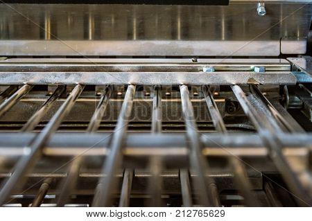 Paper Folding Machine Fold Unit Inside Metal Bars Press Closeup Inner Workings Engineering Print Pro