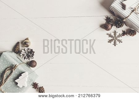 Merry Christmas Concept, Flat Lay. Stylish Presents And Gifts With Ornaments Cones Anise On Rustic W