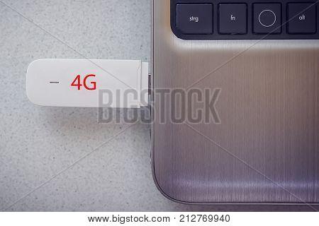 4G modem connected in modern notebook closeup