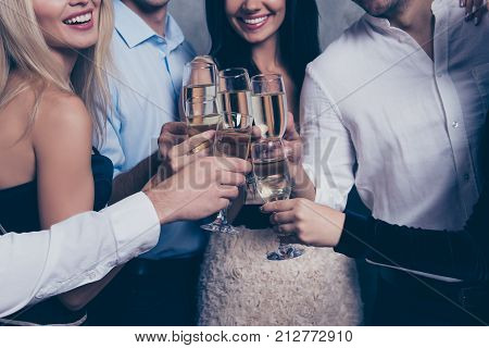 To Us! Close Up Cropped Shot Of Excited Best Friends With Beaming Smiles Celebrating With Stemware O