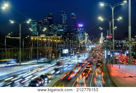 MOSCOW, RUSSIA - NOVEMBER 08: 2017:Night traffic at the center of Moscow. Night view of Sadovoye Ring road with the office buildings of Moscow City on the background.
