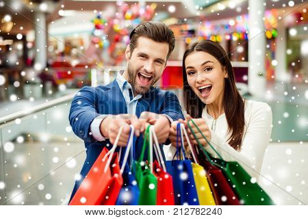 It's Crazy Shopping, Joy And Fun Time. Cheerful Successful Happy Young Lovely Couple Holding In Hand