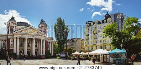 Sofia, Bulgaria - September 12, 2017: People walk through the square in front of National Theater Ivan Vazov - the oldest and most authoritative theatre and one of the important landmarks of Sofia