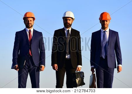 Urban Construction And Business Concept. Workers And Engineer Hold Meeting