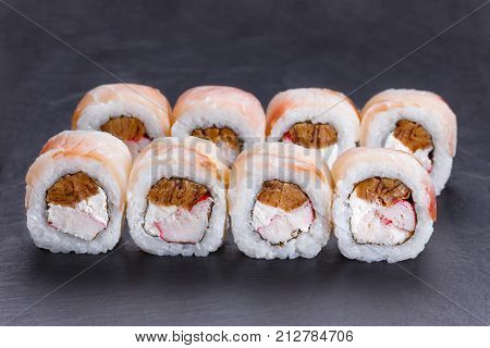Delicious Uramaki Sushi Rolls With Crab Meat, Omelet And Cream Cheese Covered With Redfish