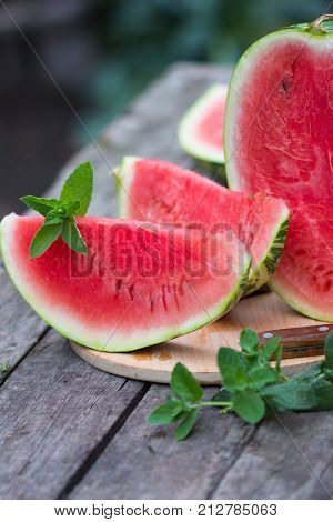 Watermelon slice on white wooden background top view flat lay/ watermelon whole. watermelon only