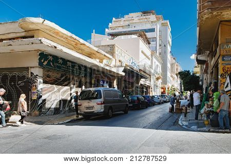 Athens, Greece - September 22, 2017: Evripidou Street, where Varvakeios Municipal Market is located, is full of small shops selling various commodities. Commercial centre of Athens.