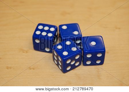 Blue six-sided dice, ready to play with.