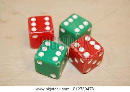 Worn dice that have been played with a lot.