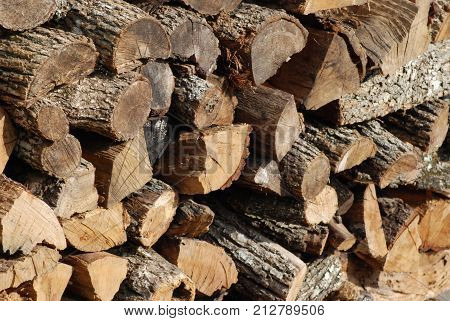 Large stack of firewood, cut and ready to use.