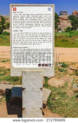 Hampi, India - November 20, 2012: Signpost for tourists with the pointer to the ancient ruins of Hampi - Badaviling Temple in Hampi, Karnataka, India.