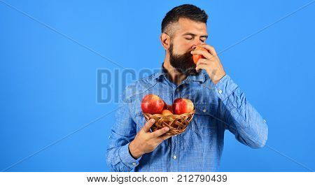 Farmer With Dreamy Face Smells Red Apple. Farming And Crops