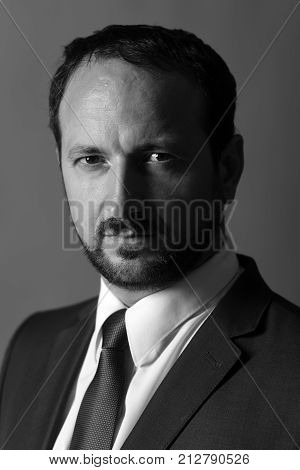 Man With Beard And Serious Face Manages Business.