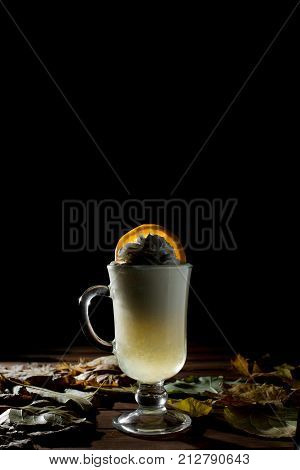 Coffee or Tea. Brown Cup of hot beverage with Steam. Espresso Coffee closeup