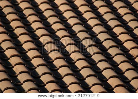 Side view of red clay Spanish tiled roof.