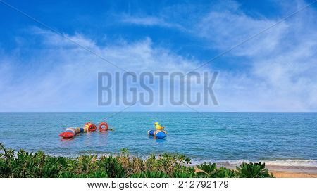 Tropical Trinity Beach on sunny day with water sport equipment