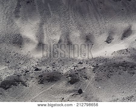 Abstract Background Texture Of Stone Gray Mountain Slope With Small Screes Creating A Natural Patter