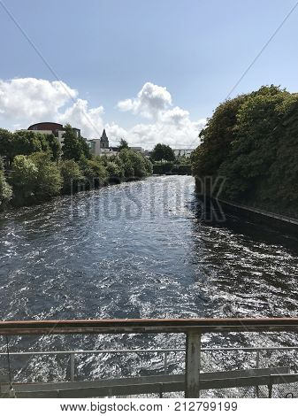 View of flowing river from a bridge in Galway Ireland province of Connach