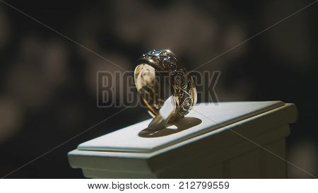Precious diamond rings. Fine luxury diamond jewellery window display with ring pedant. Gold ring with brilliant isolated on black background 4K poster