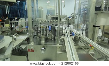 Packaging line for the production of medicines plant. Industry. pharmaceutical packing production line conveyer at manufacture pharmacy factory.