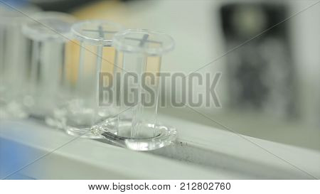 Pharmaceutical pipeline, production of medicines. pharmaceutical production line. Factory for the production of medicines, glass bottles on the conveyor. the manufacture of medicinal. apparatus for packaging medicine. Selective focus.
