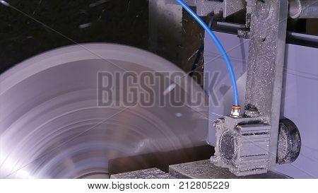 Circular saw for cutting aluminum. Sawing metal. Pendular electric saw for metal cutting, Metal sawing close up. Angel grinder make a flash sparks.