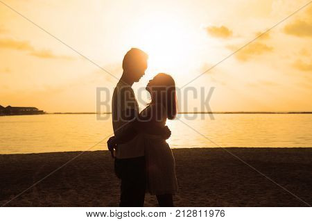 Loving couple on the beach. Couple in love. Maldives vacation. Lifestyle. Travel vacation love romance sunset.