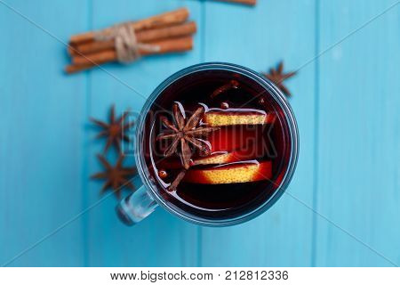 Mulled Wine, Cinnamon Sticks And Anise On Blue Background, Flat Lay. Hot Drinks, Spiced Wine, Warmin