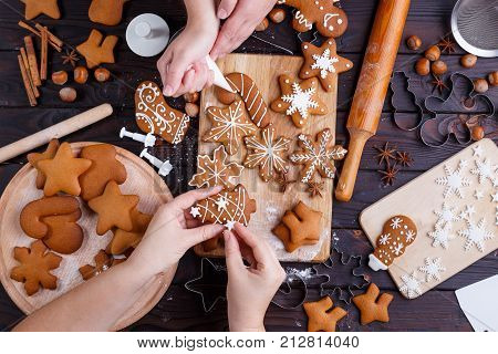 Christmas Gingerbread Making. Friends Decorating Freshly Baked C