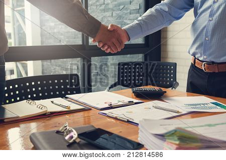 Business And Finance Concept Of Office Working, Businessmen Shaking Hand With His Partner In Confere